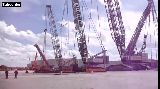 A crane lifting a crane that is lifting another crane x4