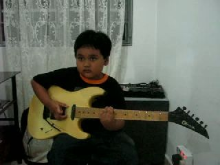 ACDC - 6 years old guitarist!